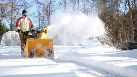 Snow blowers with heated handles